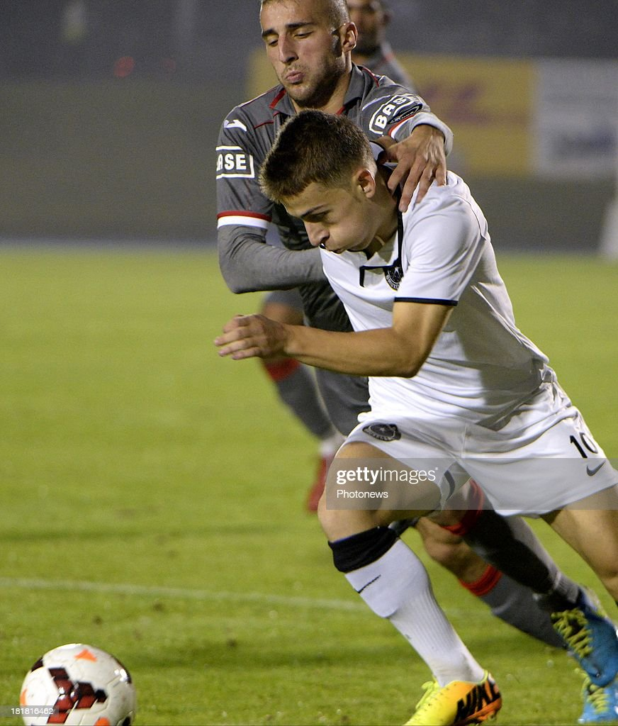 Alpaslan Ozturk of Standard liege and Kilyan Hazard of WS pictured during the Cofidis Cup match between White Star and Standard of Liege on september 25 , 2013 in Woluwe, Belgium.