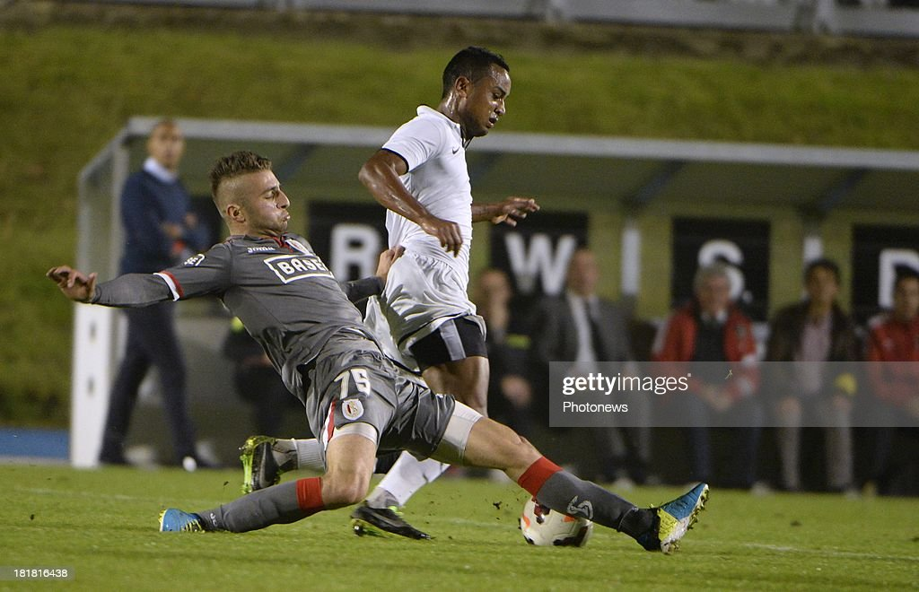 Alpaslan Ozturk of Standard liege and Loic Damour of WS pictured during the Cofidis Cup match between White Star and Standard of Liege on september 25 , 2013 in Woluwe, Belgium.