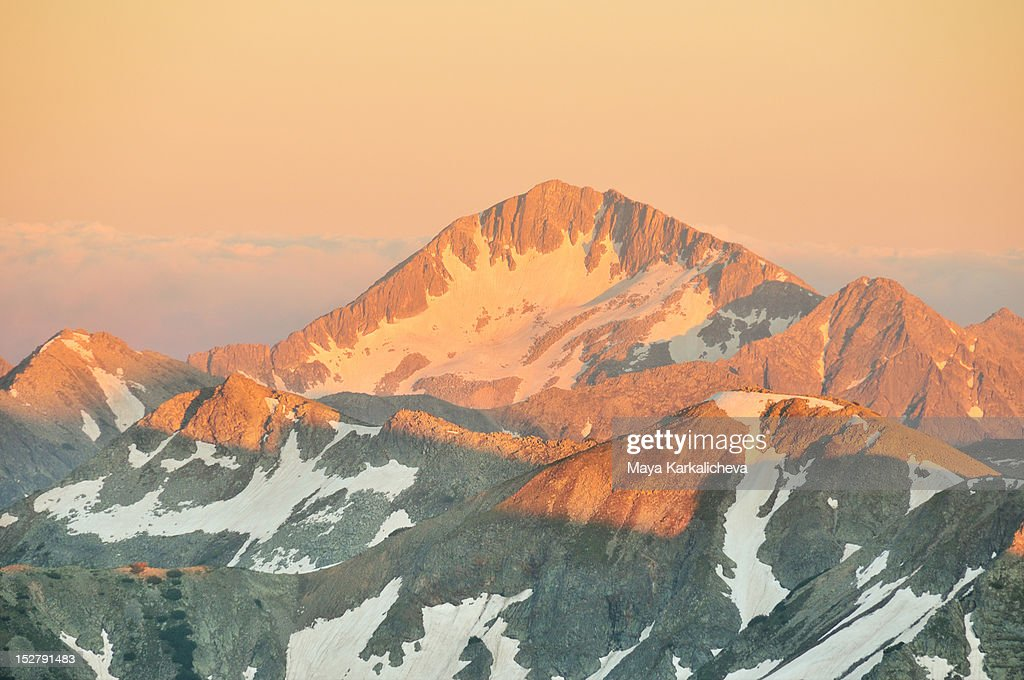 Alpenglow in mountains : Stock Photo
