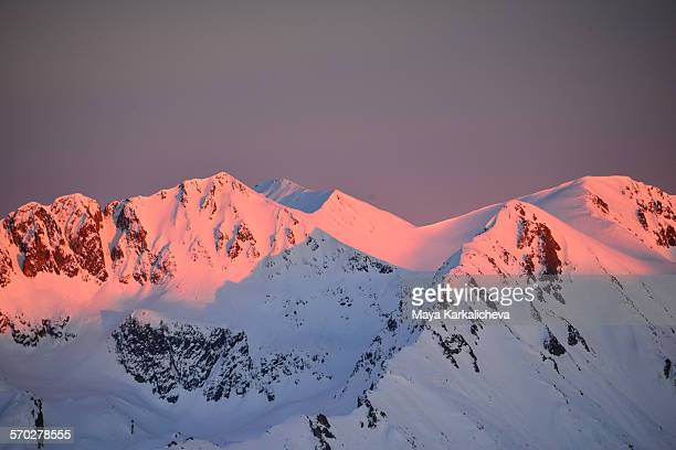 Alpenglow on a snowy mountain ridge,Pirin,Bulgaria