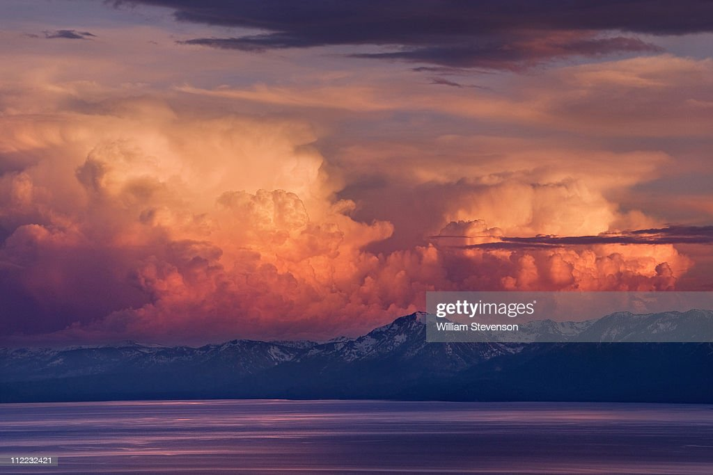 Alpenglow thunderheads at sunset over Lake Tahoe and the snow covered Sierra mountains
