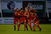 Alper Ademoglu of Belgium celebrates with teammates after scoring his team's second goal during the Under 16 Juniors International Friendly match...