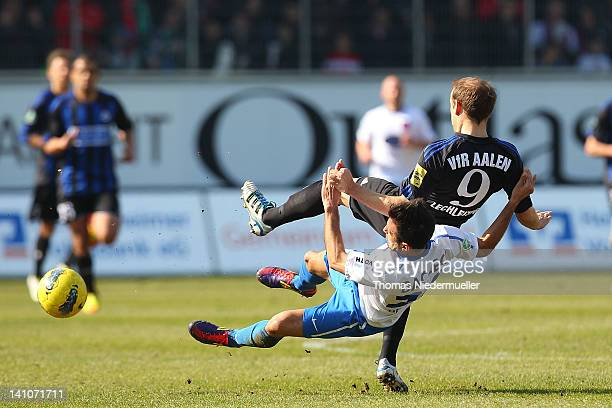 Alper Bagceci of Heidenheim fights for the ball with Robert Lechleiter of Aalen during the Third League match between 1FC Heidenheim and VfR Aalen at...