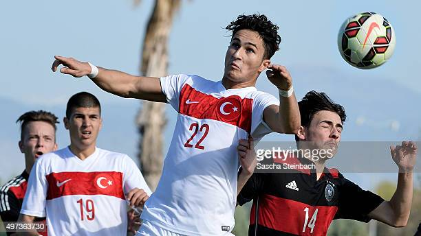 Alperen Sahin of Turkey and Angelo Rinaldi of Germany jump for a header during the U18 four nations friendly tournament match between Turkey and...