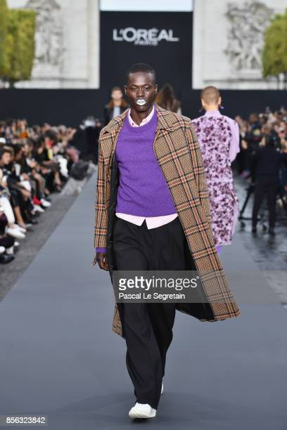 Alpha Dia walks the runway during Le Defile L'Oreal Paris as part of Paris Fashion Week Womenswear Spring/Summer 2018 at Avenue Des Champs Elysees on...