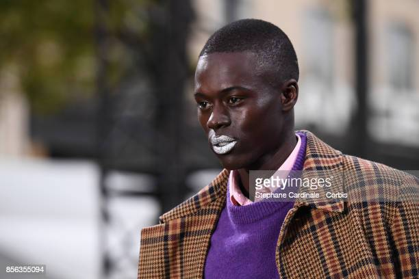 Alpha Dia walks the runway during the Le Defile L'Oreal Paris Spring Summer 2018 show as part of Paris Fashion Week at Avenue des ChampsElysees on...