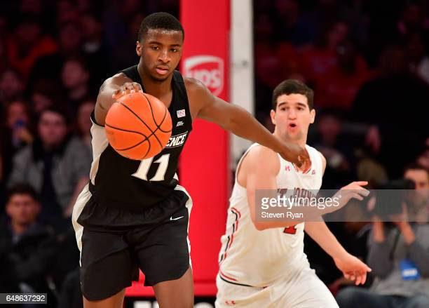 Alpha Diallo of the Providence Friars is pursued by Federico Mussini of the St John's Red Storm at Madison Square Garden on March 4 2017 in New York...