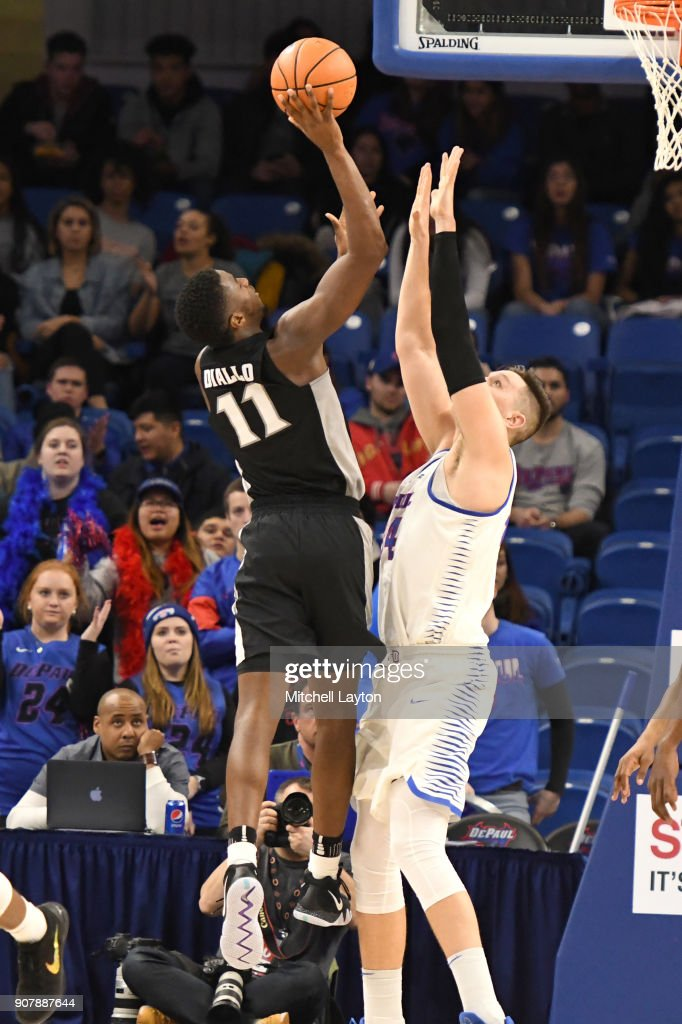 Alpha Diallo #11 of the Providence Friars takes a shot over Marin Maric #34 of the DePaul Blue Demons during a college basketball game against the Providence Friars at Wintrust Arena on January 12, 2018 in Chicago, Illinois. The Friars won 71-64.