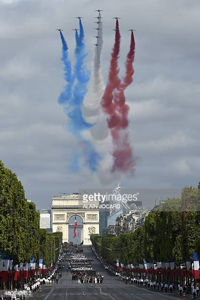 Alpha Jets of the French Air Force La Patrouille de France releasing trails of blue white and red smoke in the colours of the French national flag...