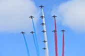 Alpha Jets of the French Air Force La Patrouille de France releasing trails of blue white and red smoke the colors of the French national flag fly in...