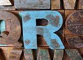 Alphabet abstract - vintage wooden letterpress types. Letter R.