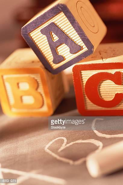 Alphabet blocks resting on chalk slate