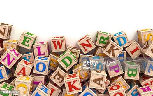 Alphabet blocks scattered at the bottom