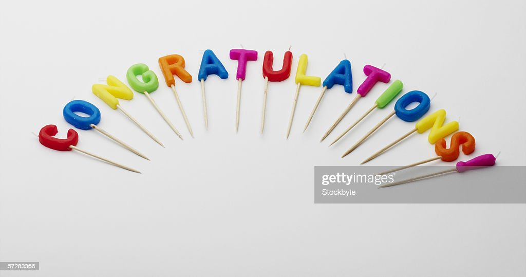 Alphabet candles displayed to spell congratulations