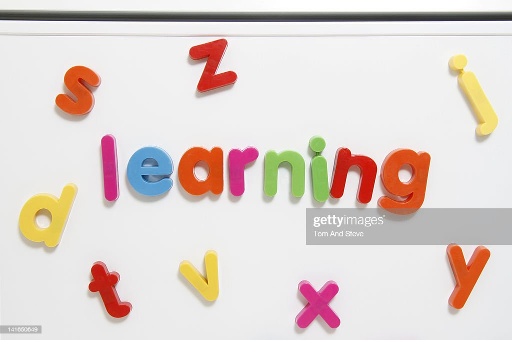 Alphabet fridge magnets spelling 'learning' : Stock Photo