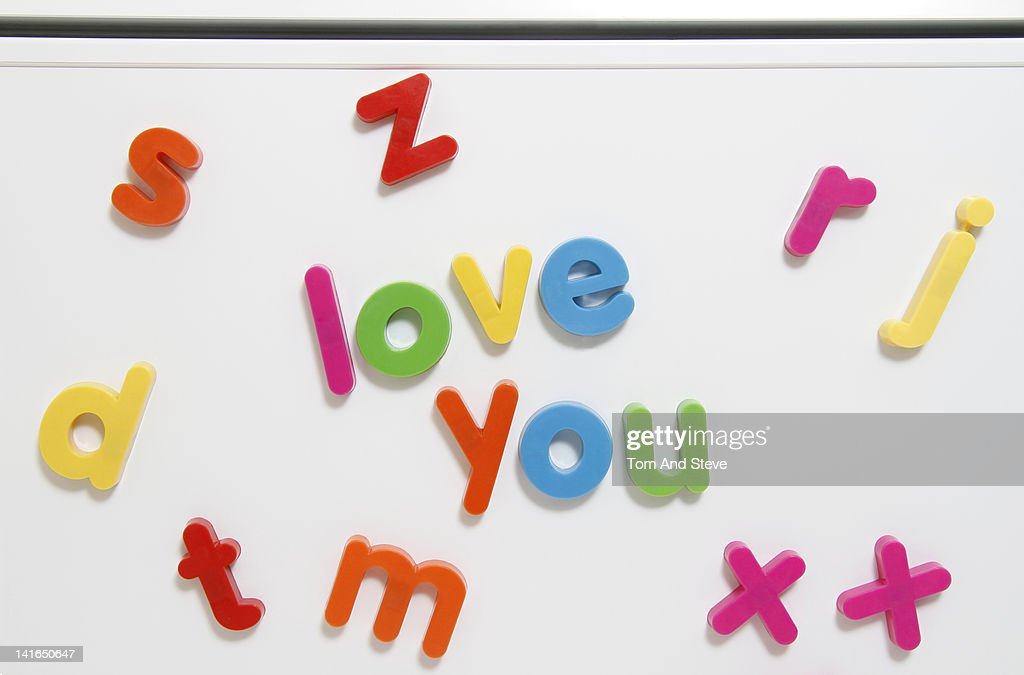 Alphabet fridge magnets spelling 'love you' : Stock Photo