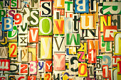 Alphabet, letters and numbers as background on wall