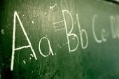 Alphabet written on chalkboard