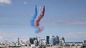 Alphajet aircrafts and an Extra EA 300 from the French elite acrobatic flying team Patrouille de France release smoke in the colours of the French...