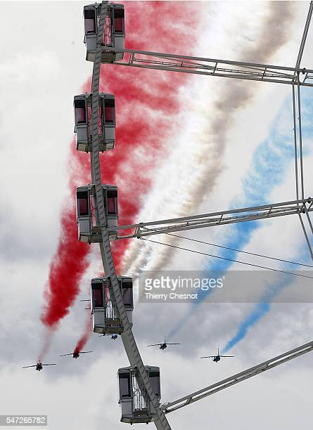 Alphajet aircrafts from the French elite acrobatic flying team Patrouille de France release smoke in the colours of the French national flag during...
