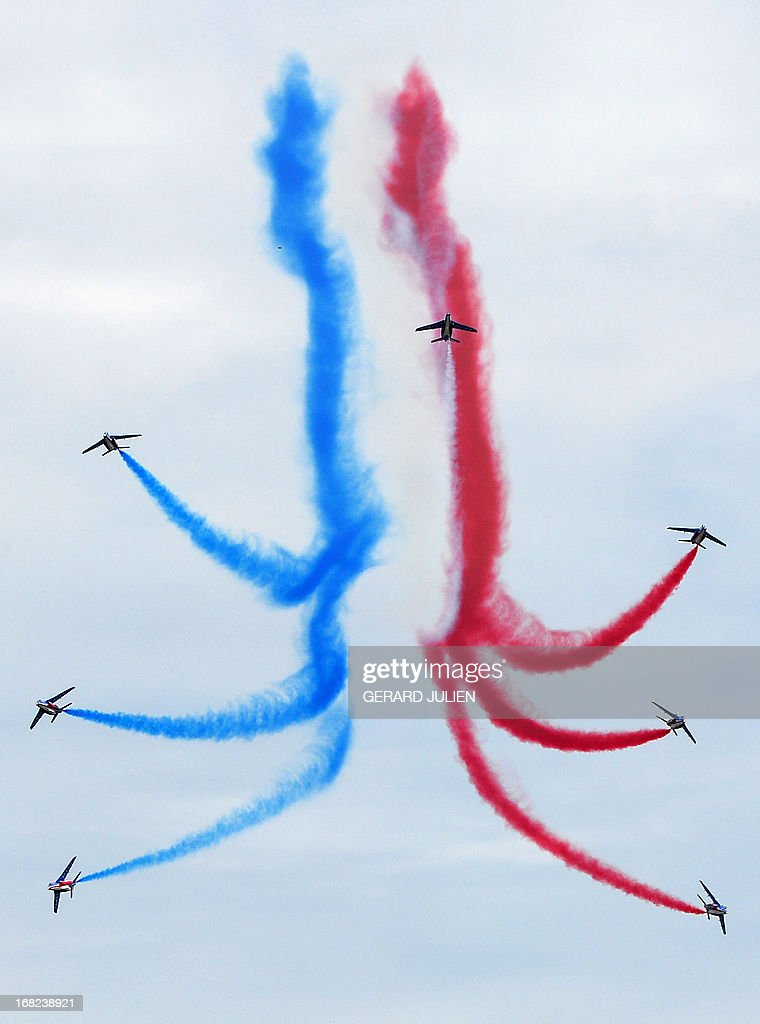 Alphajets from the French elite acrobatic flying team 'Patrouille de France' (PAF) perform aerobatics and release trails of blue, white and red smokes representing the French national flag's colors, as they fly over the 701 Air Base of Salon-de-Provence, southern France, on May 7, 2013. The Patrouille de France will celebrate its 60th anniversary on May 25 and 26.