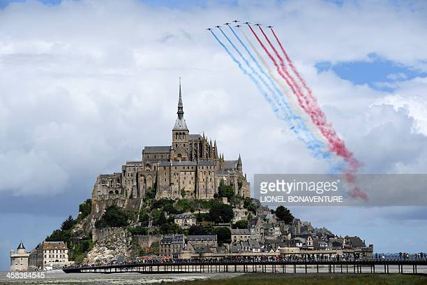 Alphajets of the French Air Force Acrobatic Patrol the Patrouille de France perform above the MontSaintMichel prior to the start of the 188 km first...