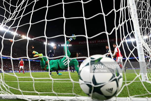 Alphonse Areola of PSG attempts to save as Alexis Sanchez of Arsenal scores his sides first goal during the UEFA Champions League Group A match...