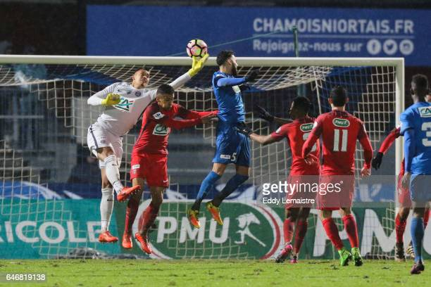 Alphonse Areola of PSG stops a goal in front of Dylan Bronn of Niort during the French Cup match between Niort and Paris Saint Germain on March 1...