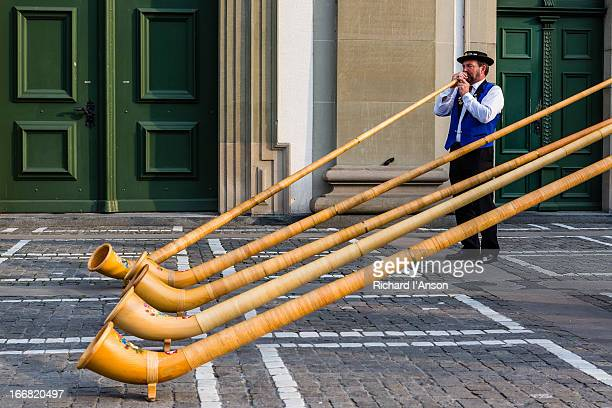 Alphorn player performing outside Jesuit Church