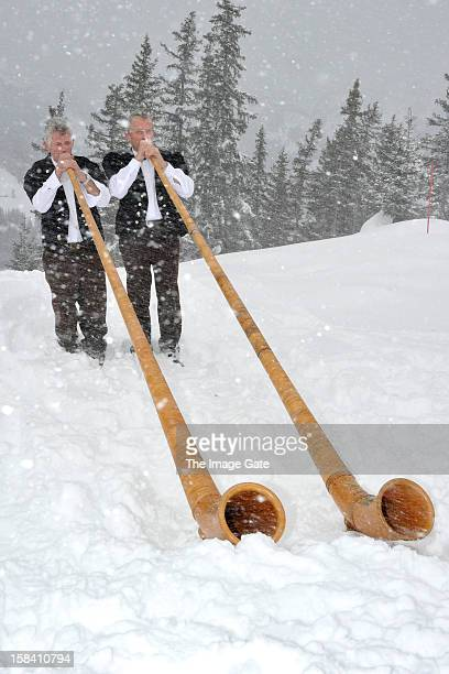Alphorn players perform during ASMALLWORLD lunch at a Mountian Chalet on December 15 2012 in Gstaad Switzerland