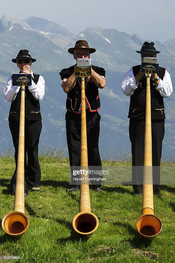 Alphorn players perform on July 28, 2013 in Nendaz, Switzerland. About 150 alphorn blowers performed together on the last day of the international Alphorn Festival of Nendaz. The Swiss folkloric wooden wind instrument was used in most mountainous regions of Europe by mountain dwellers as signal instruments.