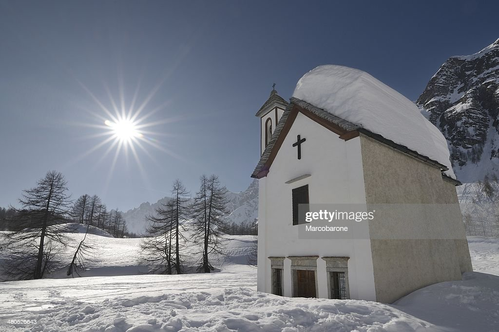 Alpine Chapel in backlight : Stock Photo