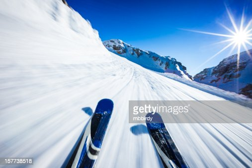 Alpine downhill skiing on sunny day