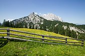 Alpine landscape with rustic wooden fence
