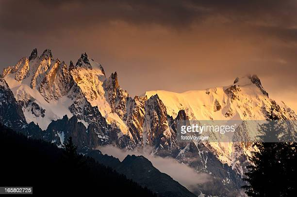 Alpine peaks pinnacles dramatic mountain sunset light