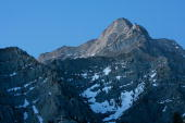 Alpine peaks rise south of Mount Whitney the tallest peak in the continental US at 14494 feet in the Sierra Nevada Mountains which carry less snow...