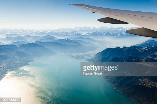 Alpine scenery from the air through the airplane window : Stock Photo