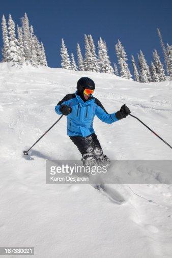 alpine skier in fresh powder snow