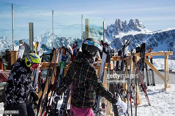 Alpine skier in the snow rest at the alpine mountain hut Rifugio Scoiattoli at the famous rocks Cinque Torri in the Dolomite Alps on March 9 2012 in...