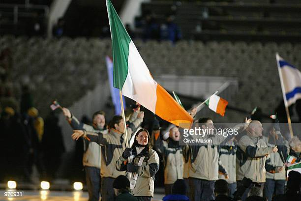 Alpine skier Tamsen McGarry of Ireland carries her nations flag during the Opening Ceremony of the Salt Lake City Winter Olympic Games on February 8...