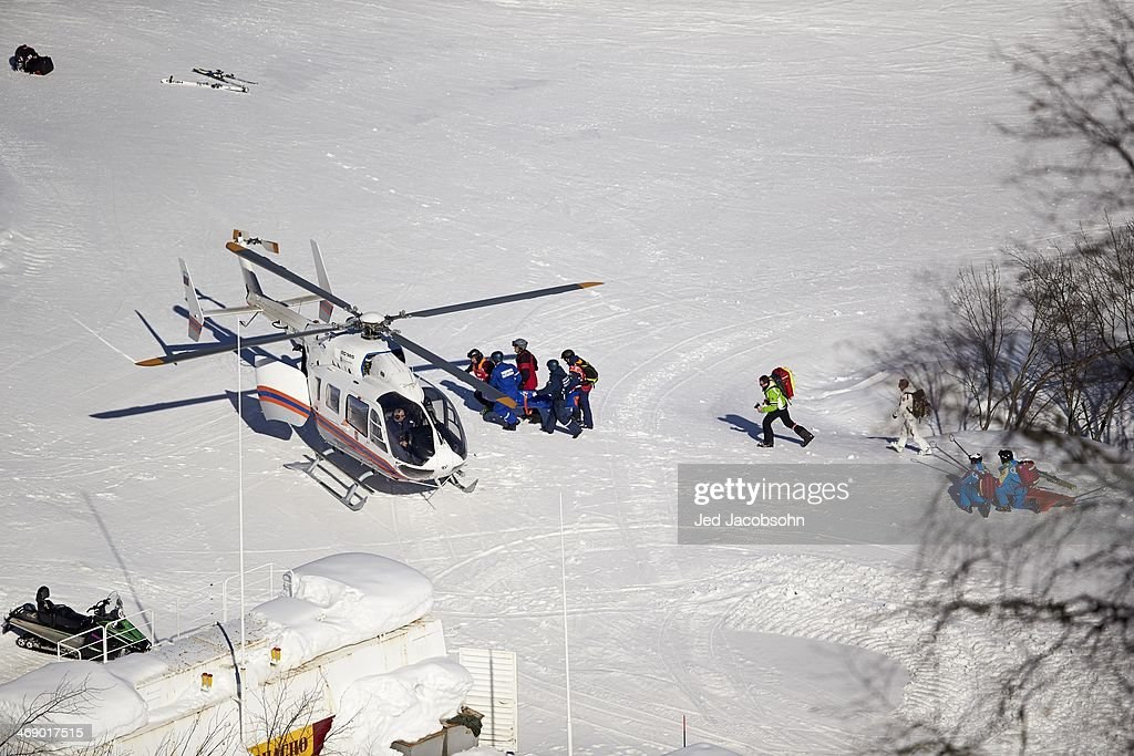 Aerial view of Spain Carolina Ruiz-Castillo being airlifted by helicopter during Women's Downhill Final at Rosa Khutor Alpine Center. Krasnaya Polyana, Russia 2/12/2014 Jed Jacobsohn X157629 TK1 R1 F399 )