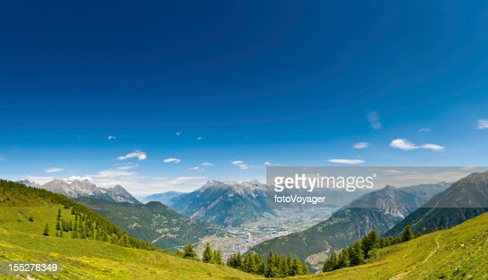 Alpine summer mountain meadow panorama Switzerland