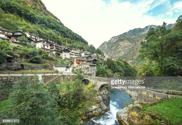 Alpine townscape of Pontboset with old medieval bridge, Valle d'Aosta, Italy