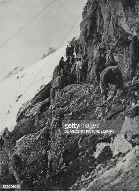 Alpini troops digging a path into the rock to close in on the enemy mountain warfare World War I from L'Illustrazione Italiana Year XLIV No 26 July 1...