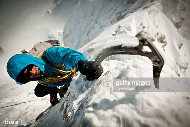 Alpinist ice climbing, on the rope, Zugspitze Mountain, Bavaria, Germany