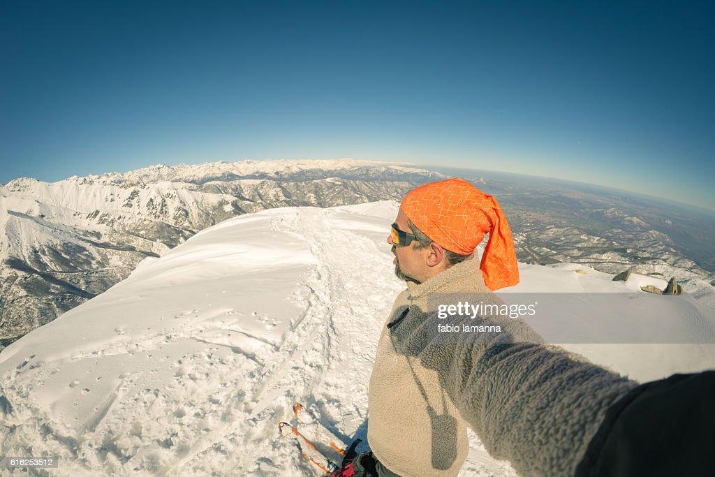 Alpinist taking selfie on snowcapped mountain, fisheye lens : Stock Photo