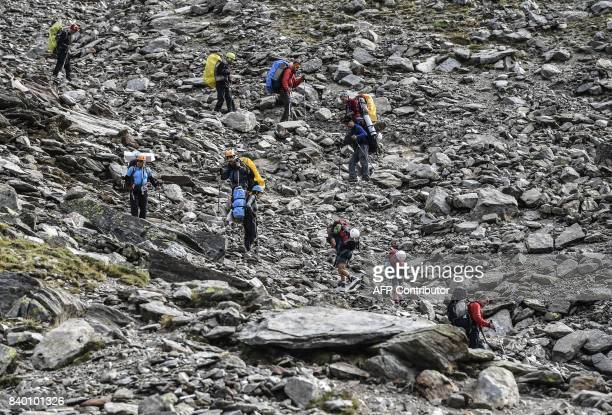 Alpinists walk on the 'voie royale' route to climb atop the MontBlanc peak via the famous 'Couloir du Gôuter' on August 27 2017 on the MontBlanc...