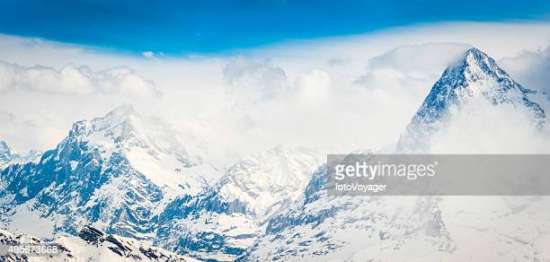Alps North Face of Eiger overlooking mountain peaks panorama Switzerland