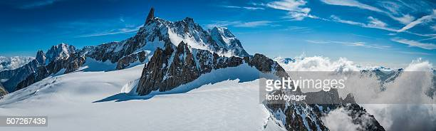 Alps rocky pinnacles crisp white snow mountain peaks above clouds