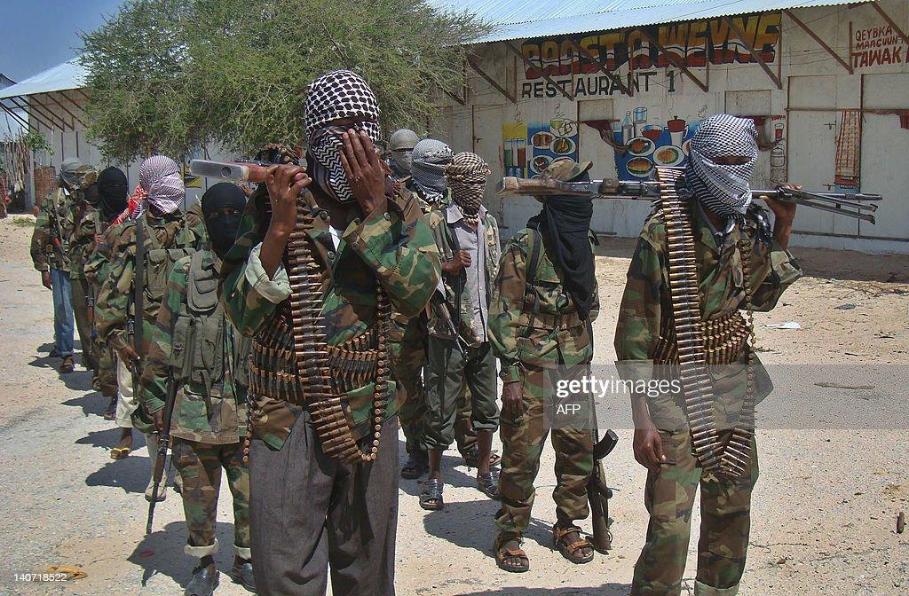 AlQaeda linked alshabab recruits walk down a street on March 5 2012 in the Deniile district of Somalian capital Mogadishu following their graduation...